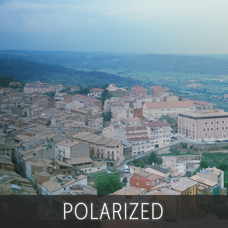 Polarized lens looking at a city for Polarized vs Non Polarized sunglasses | EyeWearThese