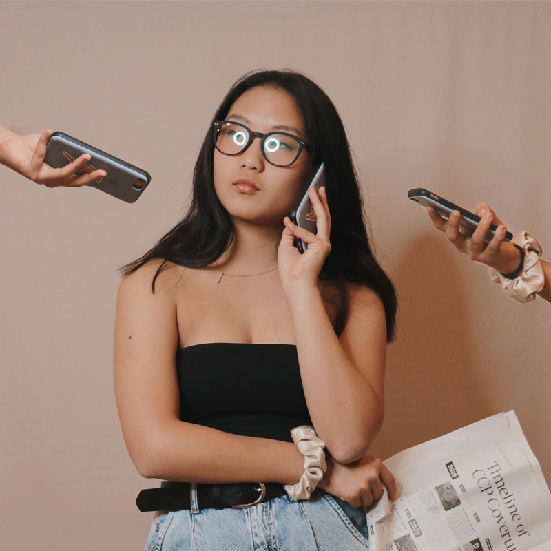 Women wearing Blue Light Protection glasses while on the phone | EyeWearThese.com