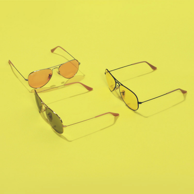 Ray-Ban 3025 Evolve Sunglasses on yellow background | EyeWearThese.com